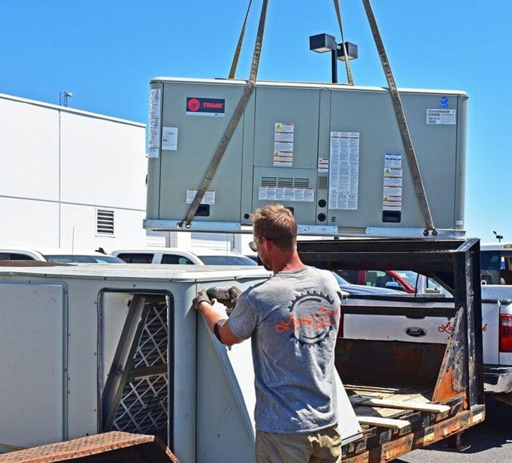 Commercial AC unit on a crane